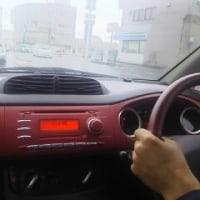 赤い綺麗なスバルの軽自動車