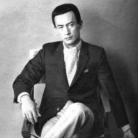 成田三樹夫。