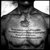 ビルマ・カレン人難民の胸のタトゥ―