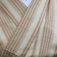 梅染刺し子織り絣縞着物と桜と春の草花模様の帯