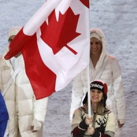 Joannie Rochette carries the Canadian flag