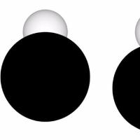 白色矮星の前を横切る壊れた岩石惑星