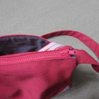帯のショルダーバッグ