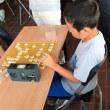 プロ棋士と。