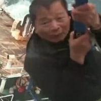 ヘリで漁船から11人を救助  中国