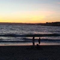 夕日と海とピクニック
