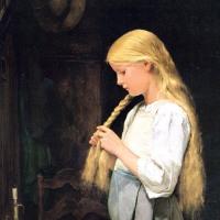 髪を編む少女
