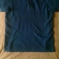 UESのポロシャツ。