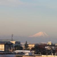 朝と夕方の富士山