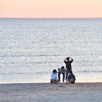 春の稲佐の浜の夕日