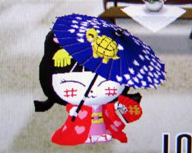 傘で亀を回す、やちにゃん