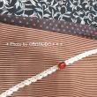 10月に着ていた着物 黒地に白の柄の着物に臙脂の縞の帯 帯揚げと帯締めでちょっとポップに