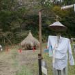 ひつじ田と藁塚のある風景
