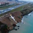 ドイツ発(datelined Germany): Plane dangles off cliff