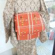 爽やかな琉球絣流水柄の単衣と名古屋帯