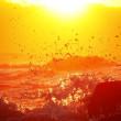 加賀海岸 戯れる波と夕陽を