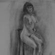 高椅子に座る女(ひと)