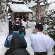 吹雪の中で春祈祷