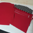 赤の帆布でがま口バッグ、パーツ製作中➰