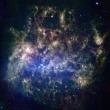 """なぜ """"大マゼラン星雲""""の一部の星は逆回転しているの? シミュレーションから見えてきた未知の銀河との衝突・合体"""