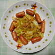 夕飯はソーセージ・キャベツ炒めでした