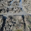 田圃の水切り作業