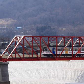 光る赤い鉄橋と1000系