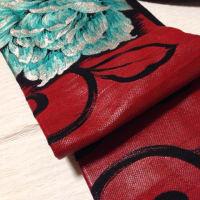 漆糸唐草に牡丹織り出し模様名古屋帯